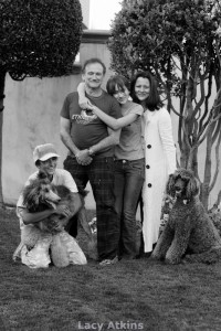Robin and Marsha Williams, with their daughter Zelda and son Cody and their two Standard Poodles, Kiwi and Mizu, at their home in San Francisco, from the book Tails of Devotion