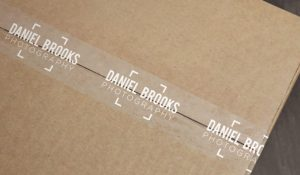 Use packing tape printed with breed information. Find it here: http://www.stickeryou.com/2/products/packing-tape/683/